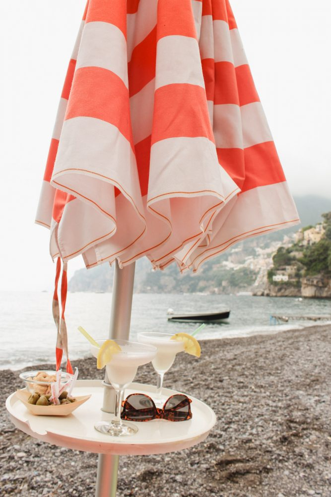 Arienzo Beach Club- Positano. Beach umbrella with cocktails