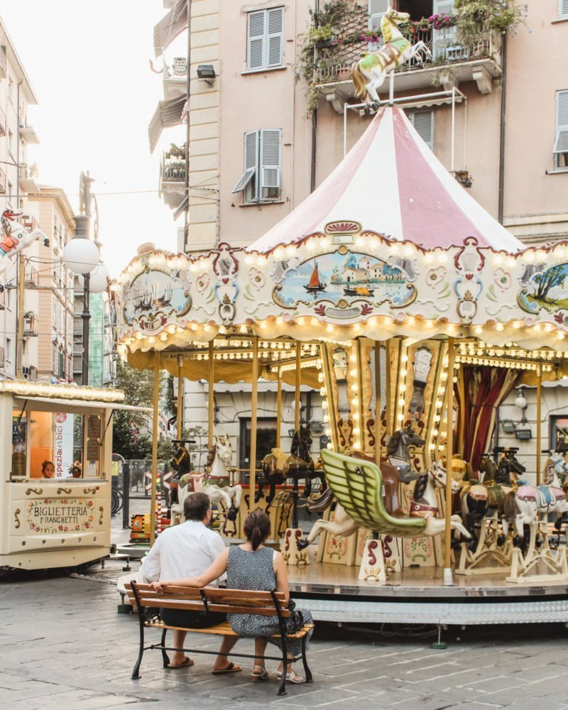 Couple in front of a carousel in La Spezia