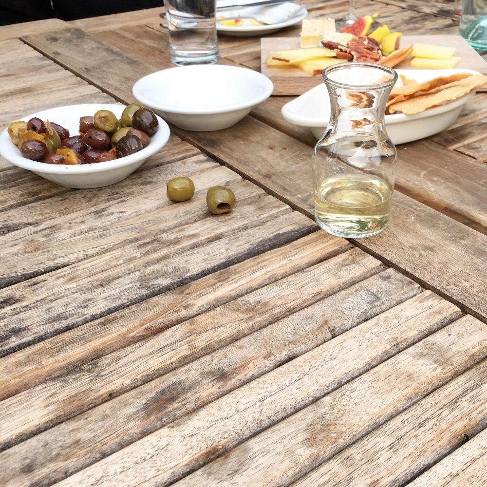 wine. sacramento. cheese plate. olives. California